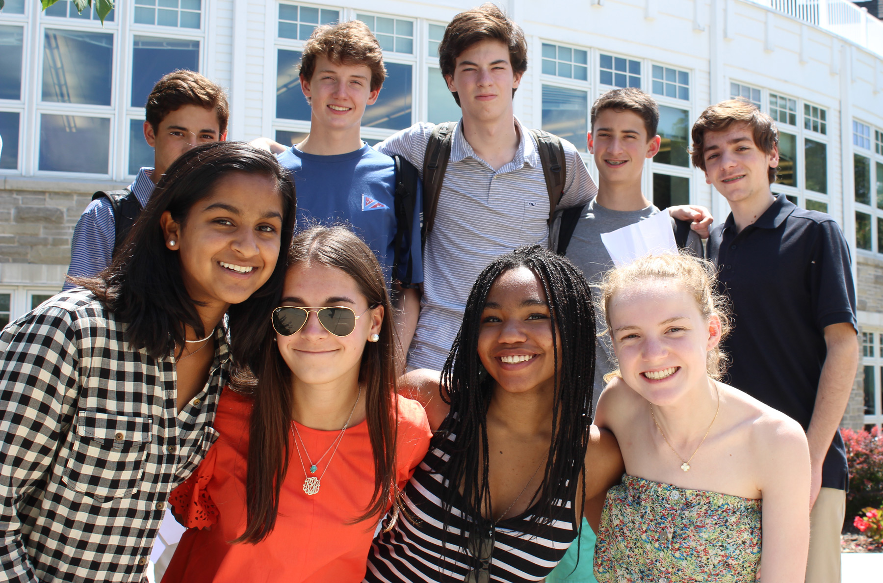 Several students standing outside posing for the camera