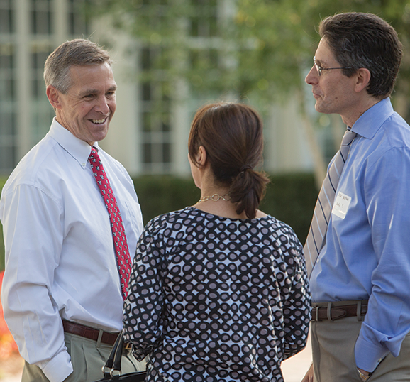 Headmaster Peter J Caldwell talks with new members of the MBS community